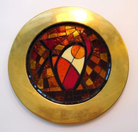 Abstract set in a brass plate.